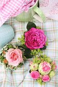 Posies of roses and fifties, polka-dotted china on checked cloth