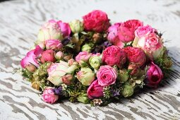 Thick wreath of flowers with pink and white roses