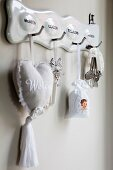 Nostalgic white key rack decorated with romantic lavender bags