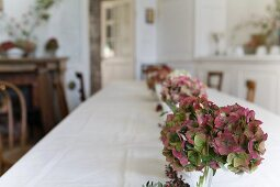 Long dining table with hydrangeas