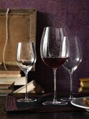 Wine glasses and books in front of a purple background