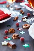 Miniature cake moulds used as table scatter decorations on table set for Christmas dinner