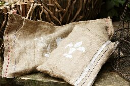 Hand-sewn hessian cushions on rustic garden bench