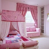 Little girl's bedroom in pink with fairy-tale elements