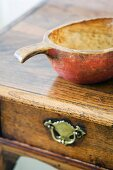 Antique wooden bowl on writing desk