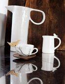 China jug, milk jug & teacup with bird ornament on rim