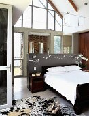 Sleeping area with double bed & cowhide rug
