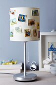 Lampshade decorated with pretty postage stamps