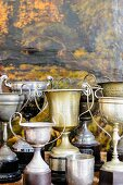 Collection of vintage trophies against black and yellow background