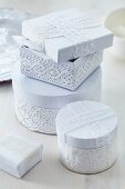 Cartons decorated with white lace trim as romantic gift boxes