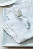 Linen napkin with hand-sewn, appliqué lace trim