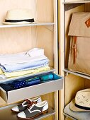 Orderly storage for men's accessories in interior of wardrobe trunk