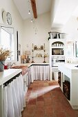 Kitchen-dining room with terracotta floor tiles in Mediterranean country house