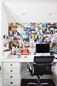 Aluminium Chair by Eames at white desk below wall covered in cuttings in teenager's bedroom