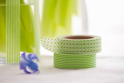 Two decorative masking tapes and a blue flower