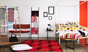 Fashionable ideas for the bedroom; colourful bed linen, scatter cushions, wardrobe and chairs