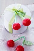 Cherry lollipops with washi tape leaves tied to small gift box