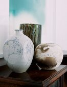 Collection of vases on small, antique cabinet