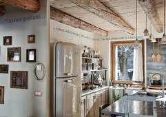 Open-plan kitchen area in wooden chalet with retro fridge & island counter