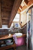 Rustic attic bathroom with small window