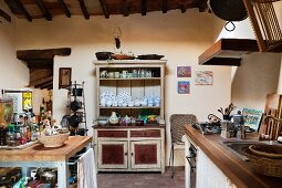 Vintage country-house kitchen with hand-painted crockery on dresser