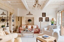 Spacious living room with comfortable upholstered furniture in shabby-chic ambiance of French country house