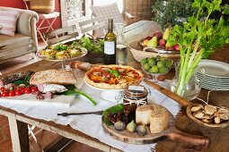Rustic wooden table set with cold appetisers in Mediterranean ambiance