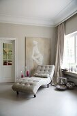 Pale leather chaise longue in room with large ceramic floor tiles