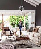 Living room in natural shades with open terrace door
