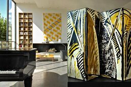Screen, modern art, bookcase and grand piano in lounge (Eric Linard art gallery, France)