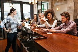 Customers drinking at bar