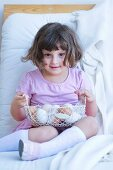 Little girl with wire basket of eggs