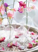 Small vases of delicate pastel flowers