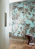 Shower room with floral mosaic in grey and blue