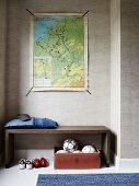Simple bench in niche; four footballs in vintage leather suitcase