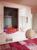 Child's cubby bed in alcove with slatted shutters