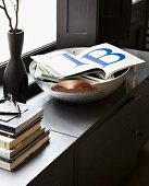 Open book of large letters on grey sideboard