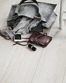 Ladies' accessories on wooden floor