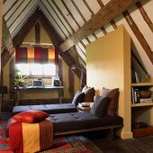 Modern bedroom with practical fittings under rustic roof structure in half-timbered house