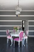 Neo Rococo chairs in silver and pink around dining table and grey and white striped wall in elegant, minimalist interior