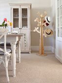 Stylised tree as hat stand, dresser and Scandinavian, country-house-style dining set