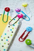 Colourful miniature buttons decorating paperclips