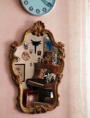 Piano reflected in antique mirror with carved wooden frame