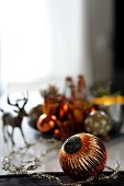Festive table decoration with Christmas tree baubles and stag figurine