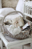 Vintage sewing utensils in wicker basket on old chair