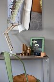 Vintage chair, small desk, modern lamp and artistic photo