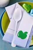 Linen napkin with iron-on apple on plate