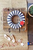 Maritime, blue and white striped fabric ring with red star motif on wicker chest