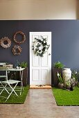 Various decorative wreaths made of feathers, artificial flowers and wicker as wall and door decorations