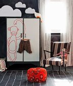 Child's bedroom with chalkboard walls and floor and flip-chart-style wardrobe doors